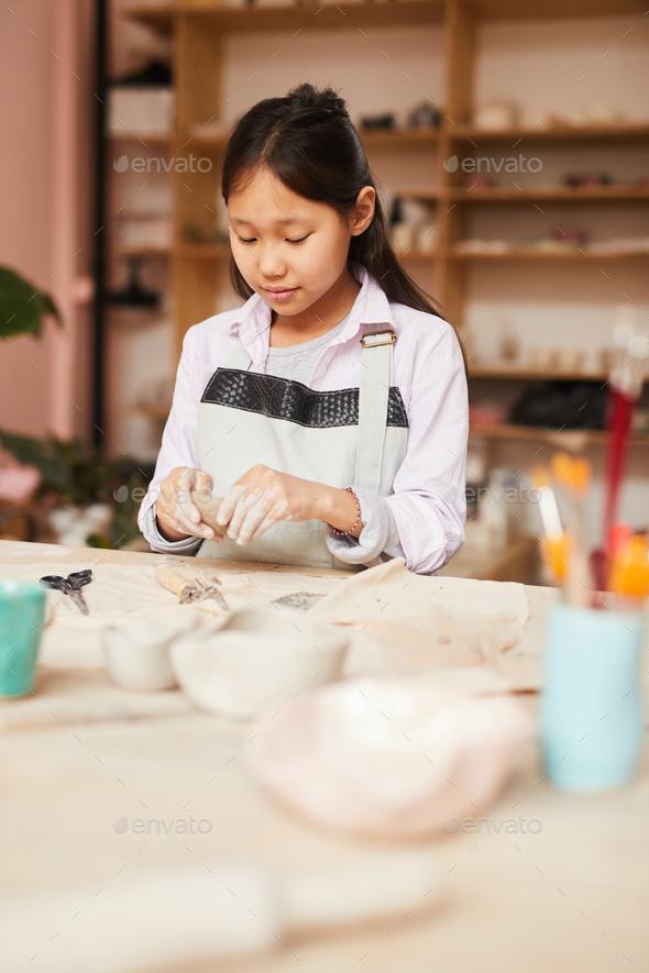 Asian Girl Enjoying Pottery Class - Stock Photo - Images