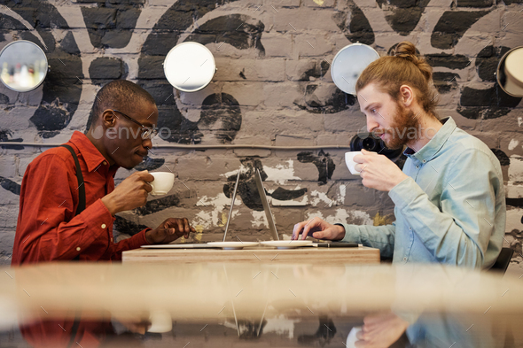 Freelancers in Cafe - Stock Photo - Images