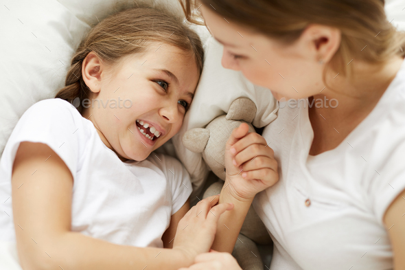 Cute Carefree Girl with Mom - Stock Photo - Images