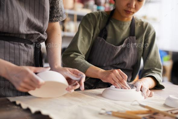 Polishing clay plates - Stock Photo - Images