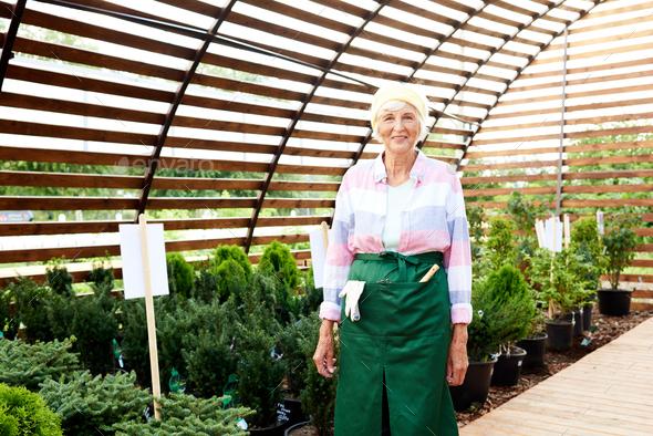 Senior Woman Posing in Garden - Stock Photo - Images