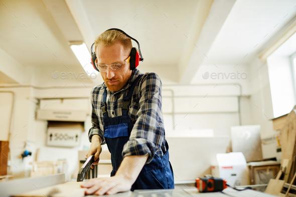 carpenter Using Cutting Machine - Stock Photo - Images