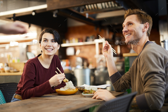 Couple in Chinese Restaurant - Stock Photo - Images