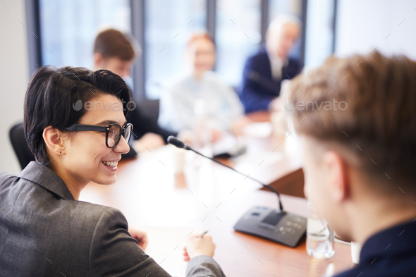 Smiling Workers in Business Meeting - Stock Photo - Images