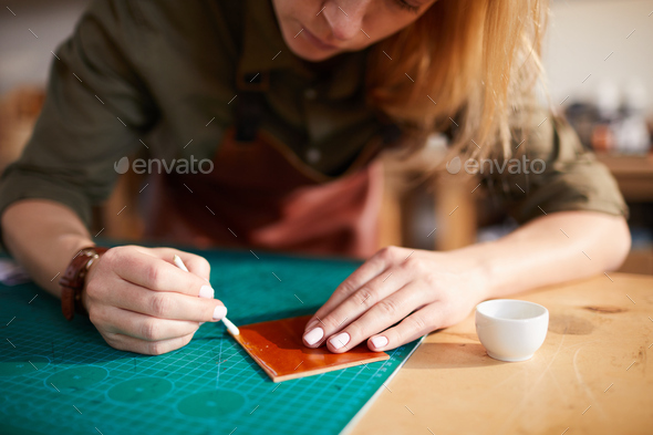 Woman doing Leatherwork Closeup - Stock Photo - Images