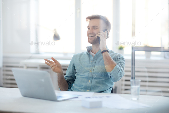 Contemporary Businessman Speaking by Phone - Stock Photo - Images
