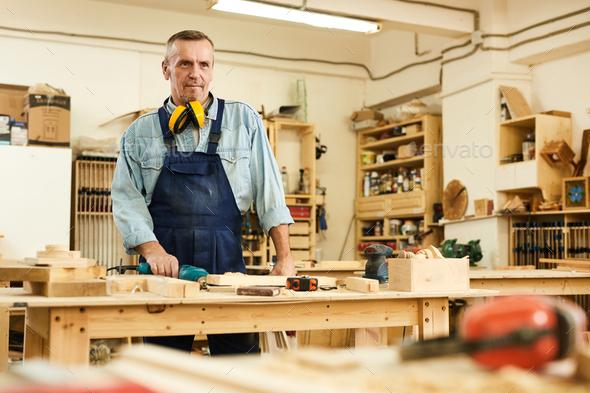 Mature Carpenter in Workshop - Stock Photo - Images