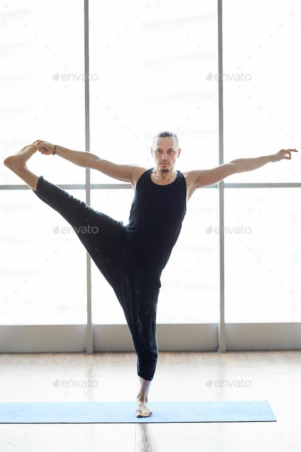 Yogis balancing on one leg - Stock Photo - Images