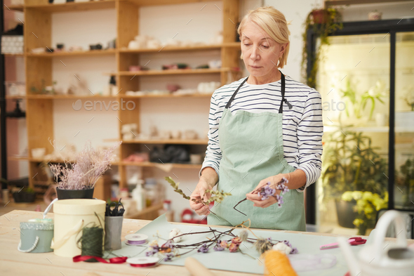 Female Florist Making Decorations - Stock Photo - Images