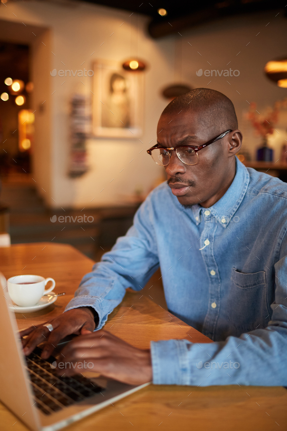 African Businessman Working in Cafe - Stock Photo - Images