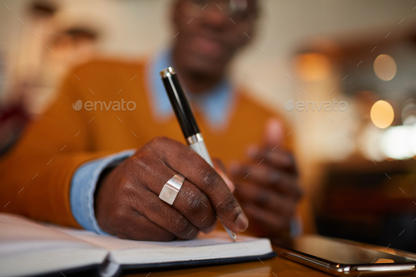 Modern African Man Writing - Stock Photo - Images
