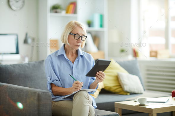Woman Calculating Budget at Home - Stock Photo - Images