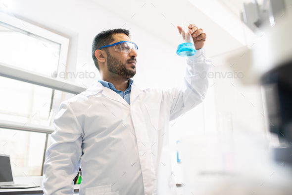 Pharmacist working on medication - Stock Photo - Images