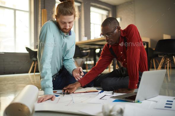 Businessmen Working Sitting on Floor - Stock Photo - Images