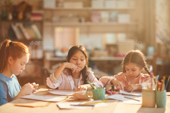 Children Painting in Sunlight - Stock Photo - Images