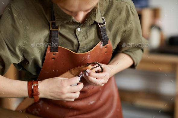 Artisan Sewing Leather Belt Closeup - Stock Photo - Images