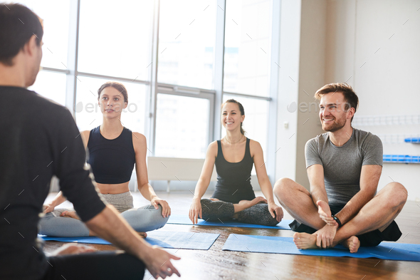 Listening to lecture at yoga seminar - Stock Photo - Images