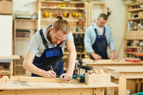 Two Workers in Carpentry - Stock Photo - Images
