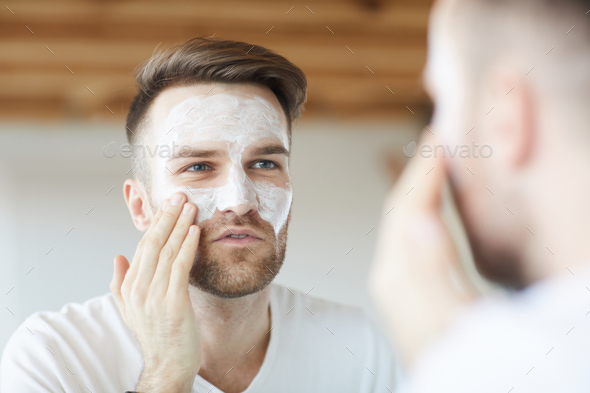 Man using Face Cream - Stock Photo - Images