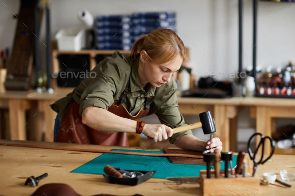 Female Craftsman Working in Shop - Stock Photo - Images