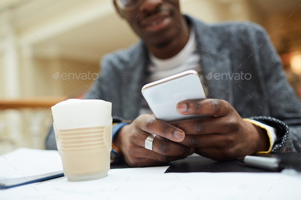 African Man Holding Smartphone - Stock Photo - Images