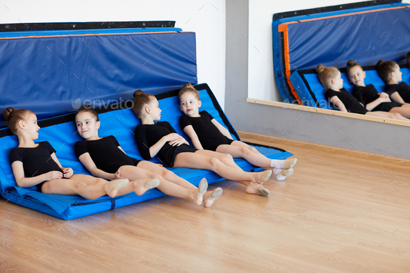 Girls Resting on Mats - Stock Photo - Images