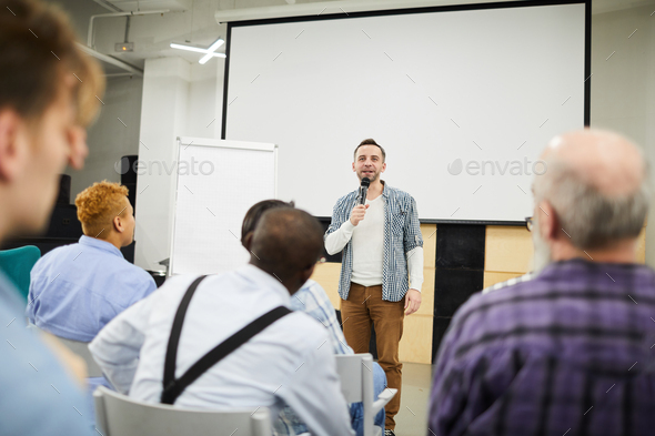 Startup entrepreneur presenting his project at conference - Stock Photo - Images