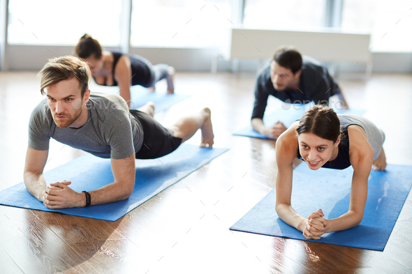 Motivated young people doing elbow plank - Stock Photo - Images