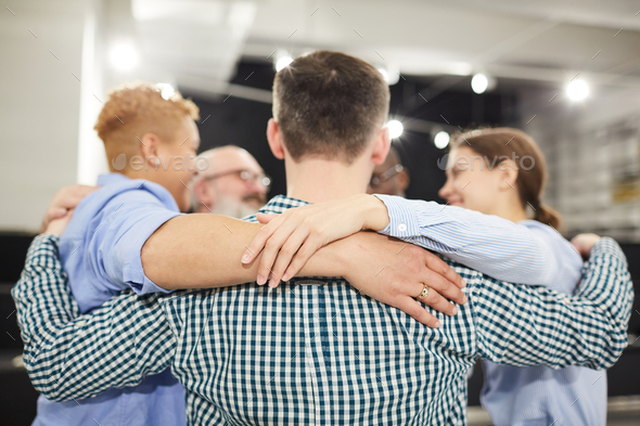 Group Hug in Therapy Session - Stock Photo - Images