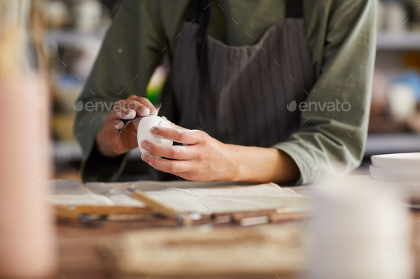 Preparing clay dish for firing - Stock Photo - Images