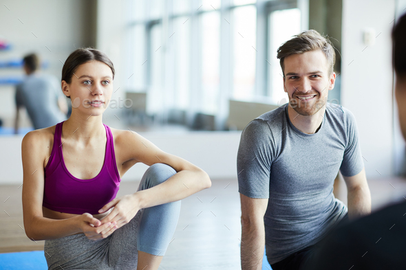 Young people chatting before yoga class - Stock Photo - Images