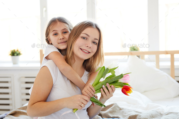 Little Girl Embracing Mother - Stock Photo - Images