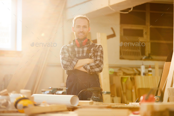 Carpenter Posing in Sunlight - Stock Photo - Images