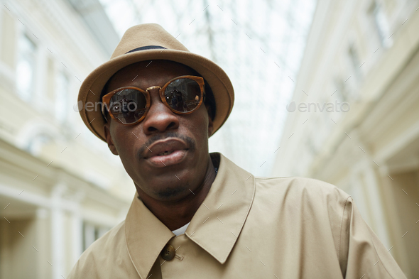 African Man Posing in Gallery - Stock Photo - Images