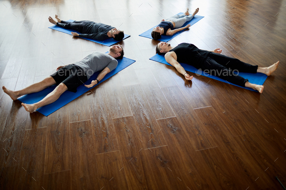 Napping at end of yoga practice - Stock Photo - Images