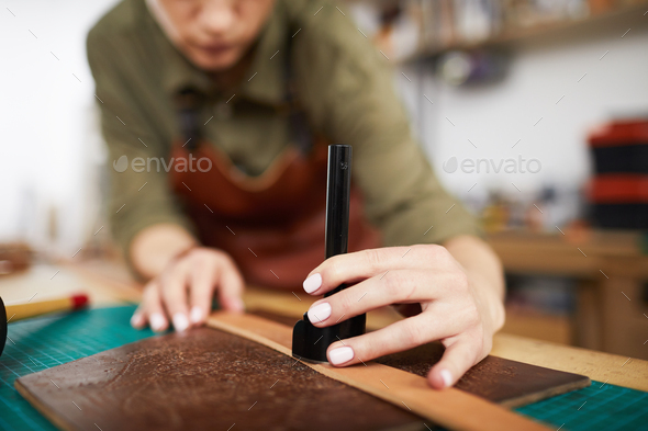 Artisan Making Leather Belt - Stock Photo - Images