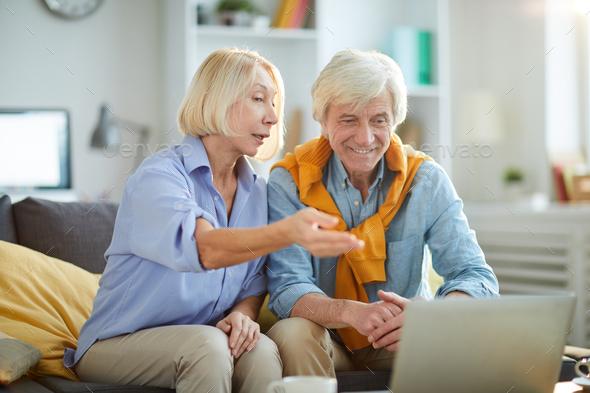Modern Senior Couple Using Laptop - Stock Photo - Images