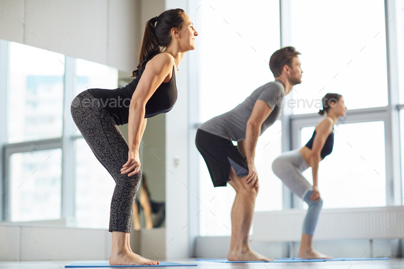 Yoga students practicing back exercise - Stock Photo - Images