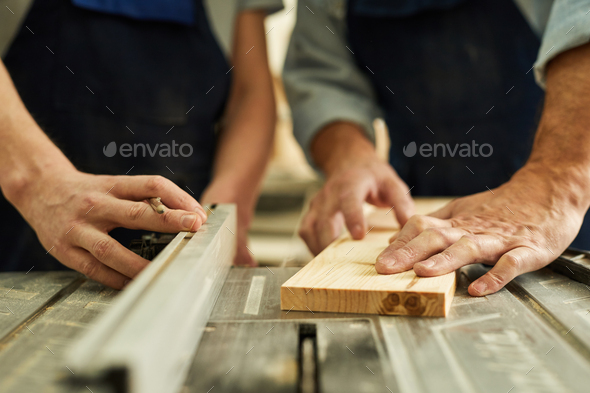 Carpenters Cutting Wood Close up - Stock Photo - Images