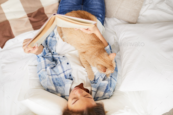 Woman Reading Book with Cat - Stock Photo - Images