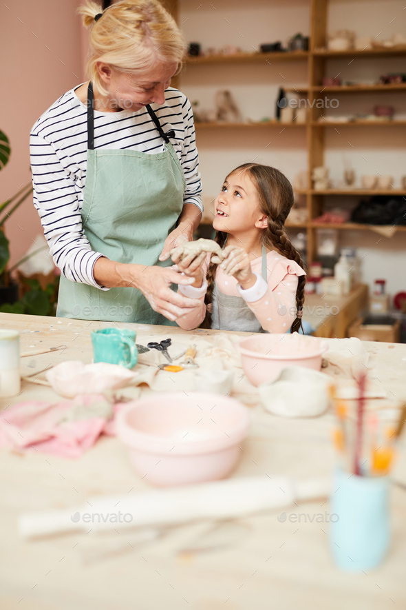 Little Girl Enjoying Pottery - Stock Photo - Images