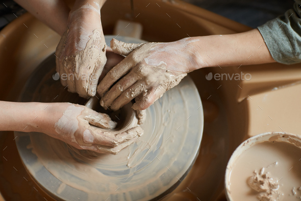 Moulding clay together on pottery wheel - Stock Photo - Images