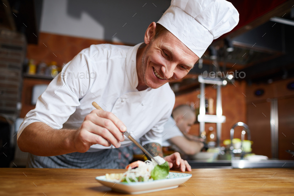 Professional Chef Plating Gourmet Dish - Stock Photo - Images