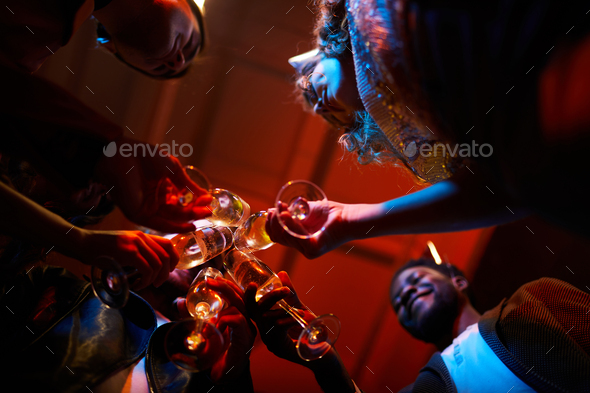 Friends drinking alcohol at birthday party - Stock Photo - Images