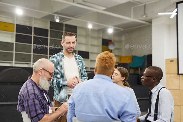 Man Introducing himself at Support Group Meeting - Stock Photo - Images