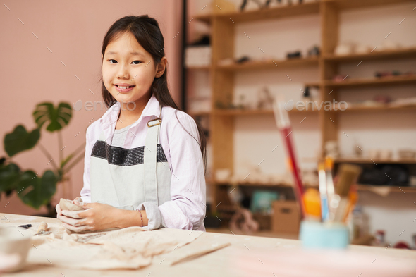Happy Asian Girl in Pottery Class - Stock Photo - Images