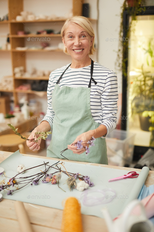 Florist Smiling at Camera - Stock Photo - Images