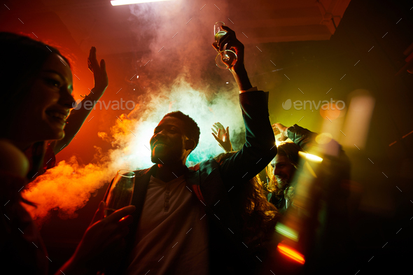 Hilarious people at noisy party - Stock Photo - Images