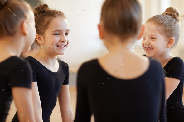 Girls Giggling in Dance Class - Stock Photo - Images