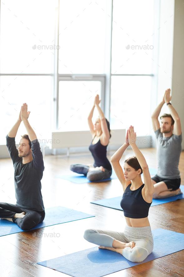 Sun meditation at yoga class - Stock Photo - Images